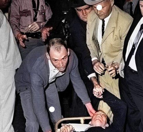 Oswald holding hands after Ruby shot him