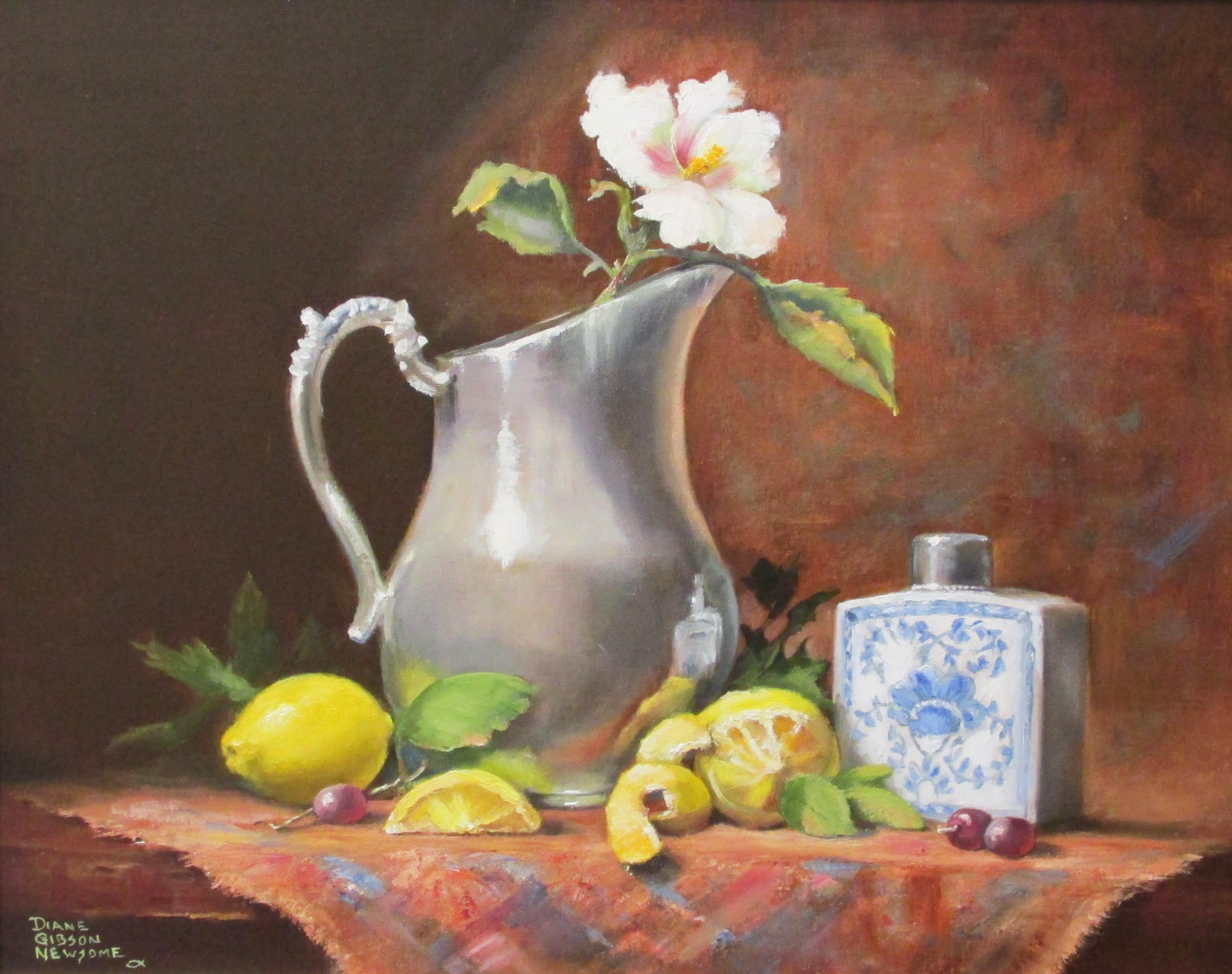 Silver Pitcher With Lemons