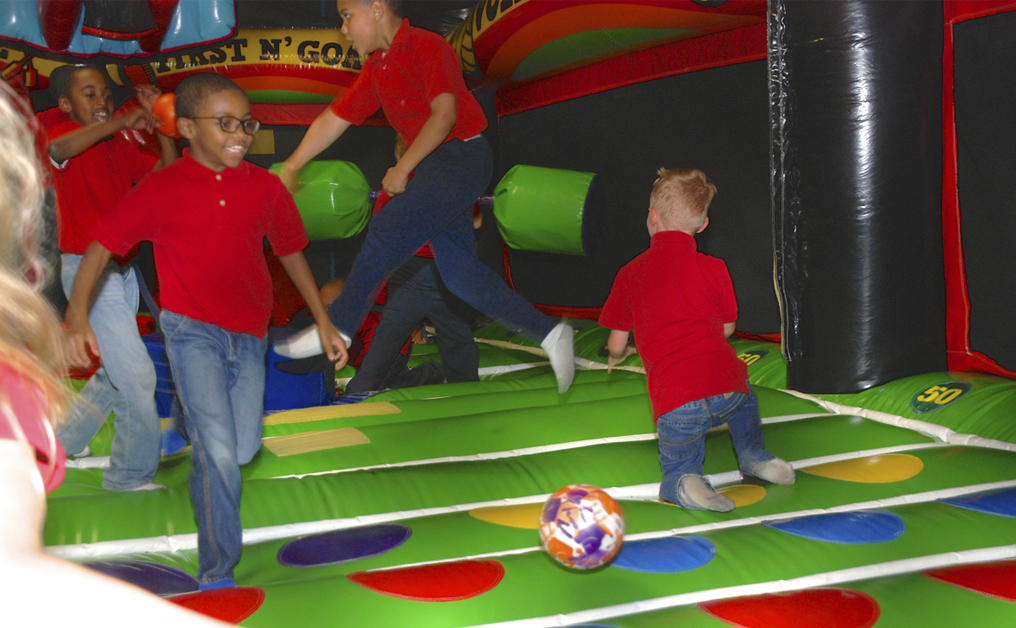 boys and girls playing in giant inflatable jumpers at Indian Lanes