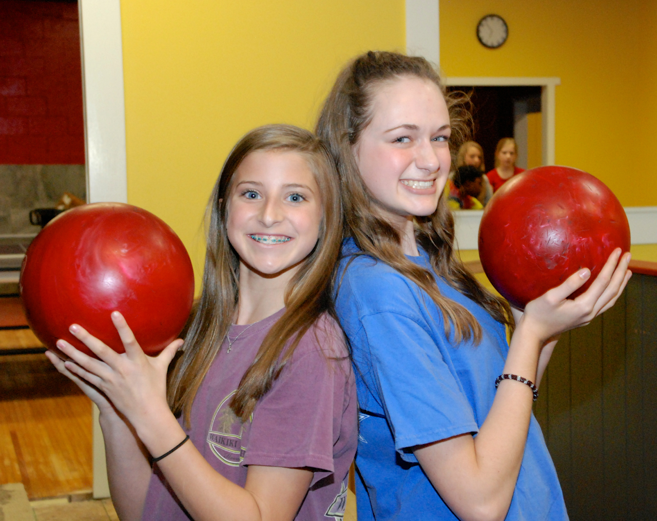 Teenage girls holding red bowling balls Indian Lanes Center Party Zone Clinton MS