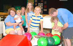 family group bowling during birthday party at Indian Lanes