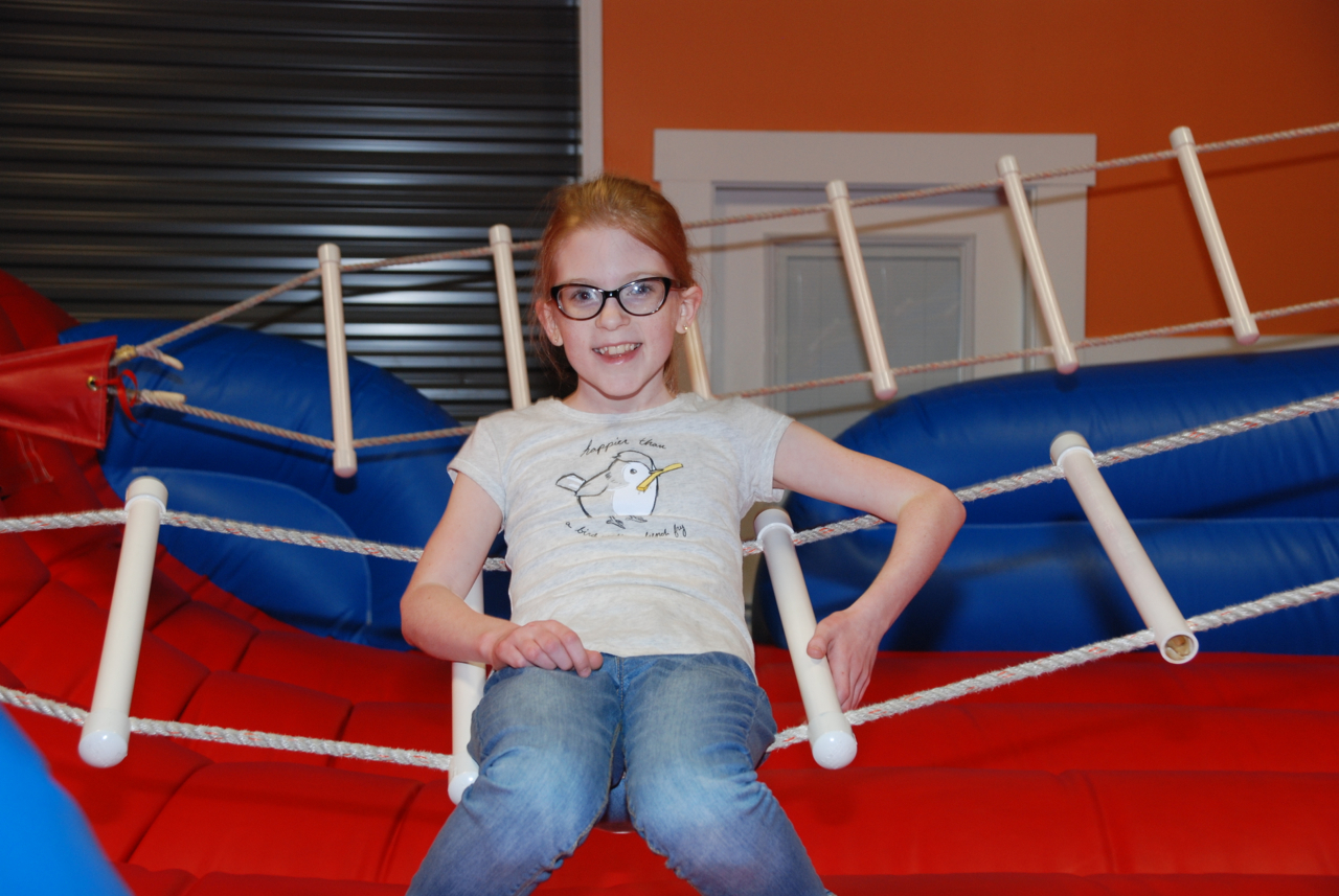 cute girl on ropes in jump zone at Indian Lanes