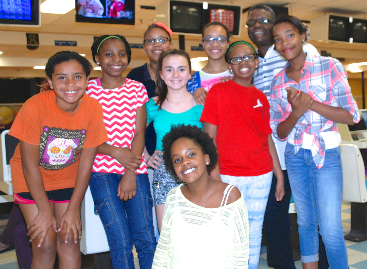 group of girls bowling during birthday party