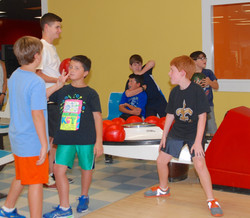group of boys bowling at Indian Lanes