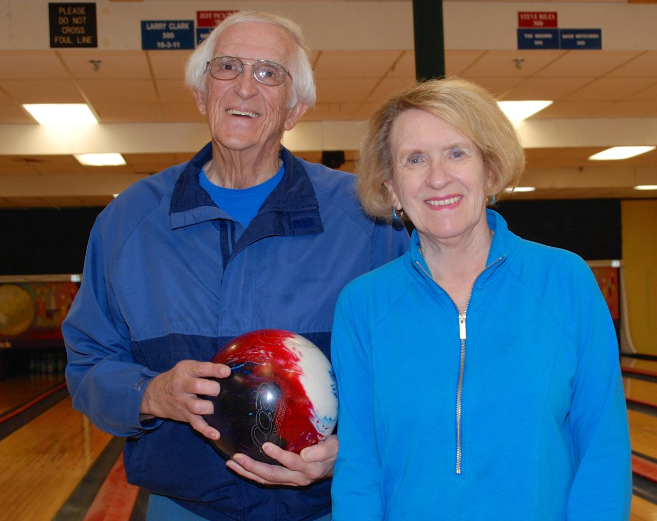 man and woman bowling at indian lane