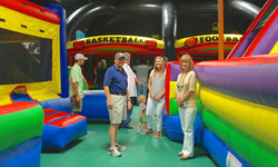 Adults watching kids play inflatable jump zone Indian Lanes
