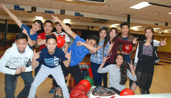 group young adults bowling