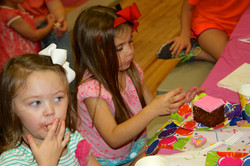 girls eating birthday cake