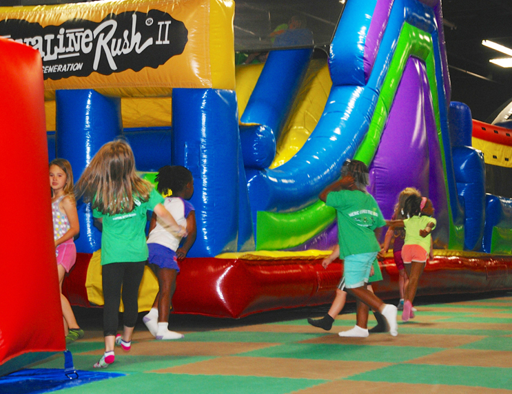 kids playing on giant inflatable jumpers indian lanes clinton ms