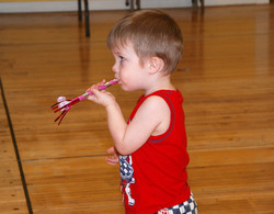 little boy with birthday party horn