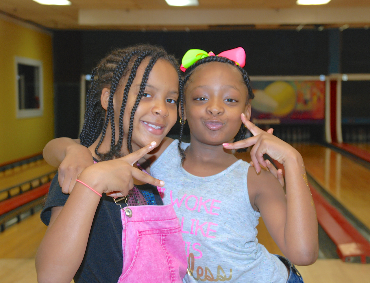 two young girls bowling indian lanes clinton ms