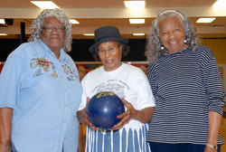 three women bowling at indian lanes