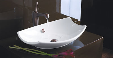 chrome faucet and white bathroom sink