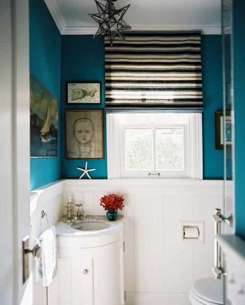 small bathroom; corner vanity and sink