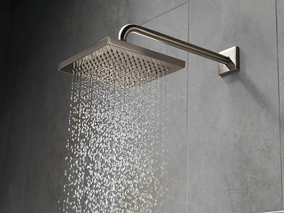 Chrome shower head with water coming out