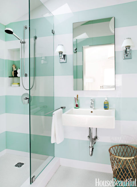 bathroom with glass shower and green striped walls