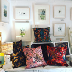 Lucy Rose cushions with Maggie Smith's framed work