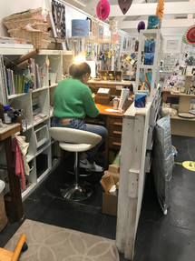 Millie Hann working behind our counter at the gallery