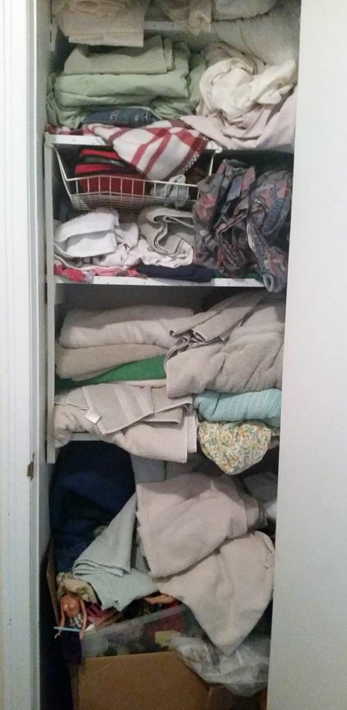 disorganized linen closet