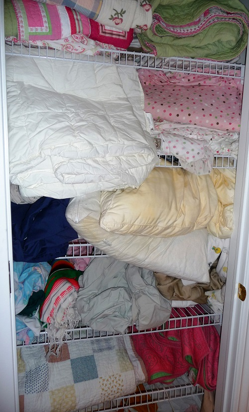 linen closet before organizing