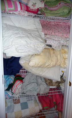 linen closet before organizing
