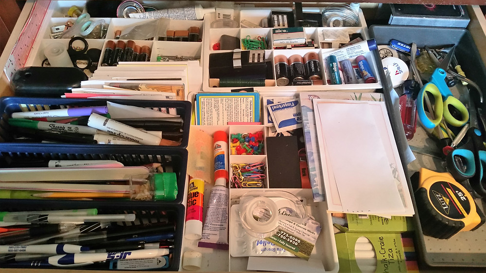 Junk drawer before purging and organizing