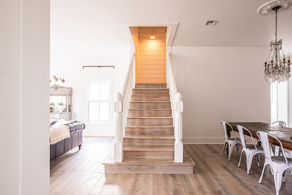 Custom Texas Post Oak stairs add warmth and texture to this modern day Texas Farmhouse