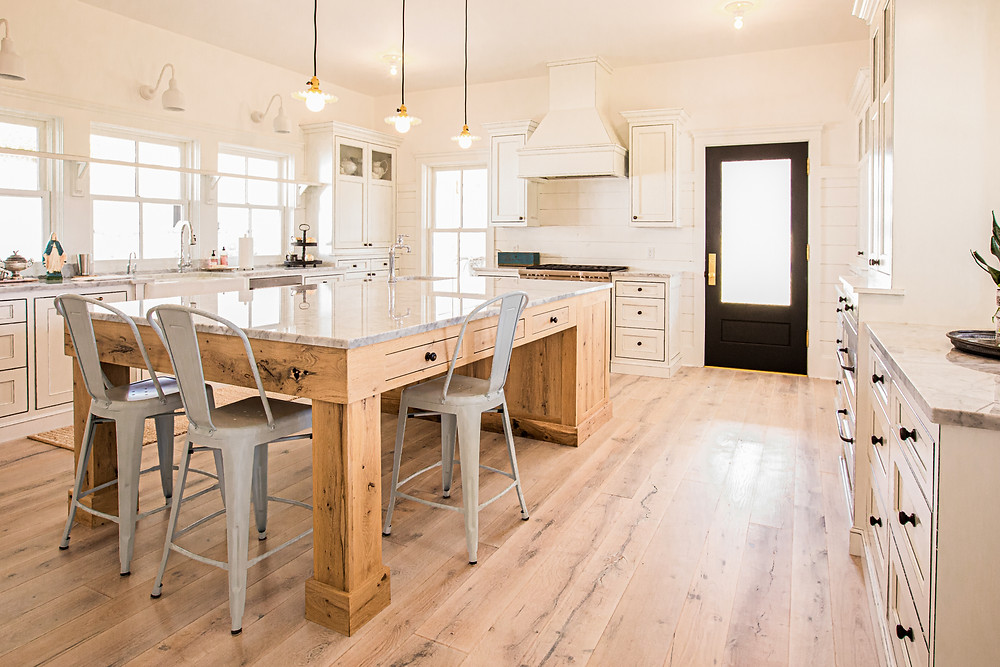 Salvaged Texas Post Oak Wide Plank hardwood flooring in modern farmhouse kitchen.