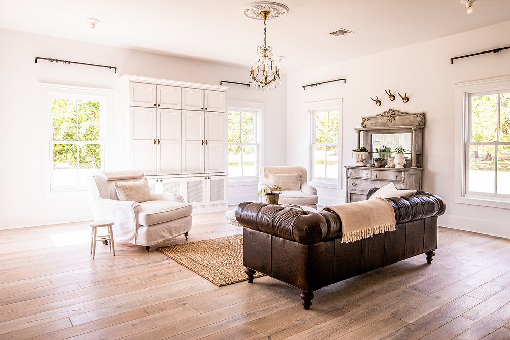 Rustic wide plank Texas Post Oak floors add warmth and texture to this modern day Texas farmhouse set just blocks from the town square