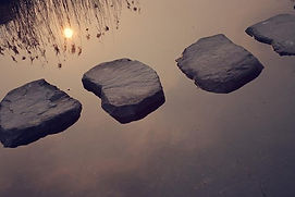 Stepping stones stretching across water.