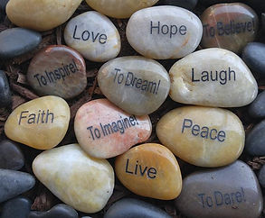 Stones with words like hope, love, and peace engraved on them.