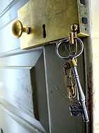 Large brass door lock with a skeleton key.