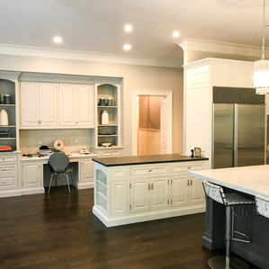 White Carrara Honed (Marble) and Absolute Black Leathered (Granite)