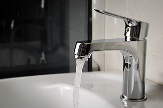 water-flows-from-tap-faucet-bathroom-cop