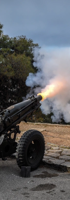 A soldier fires a cannon from Lycabettus Hill as Greece celebrates the 200th anniversary of the War of Independence.