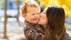 Mother kissing toddler