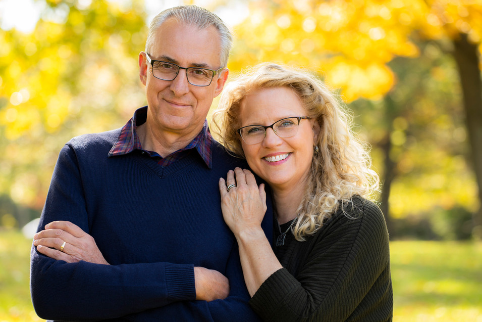 Professional outdoor family portrait of an elderly couple
