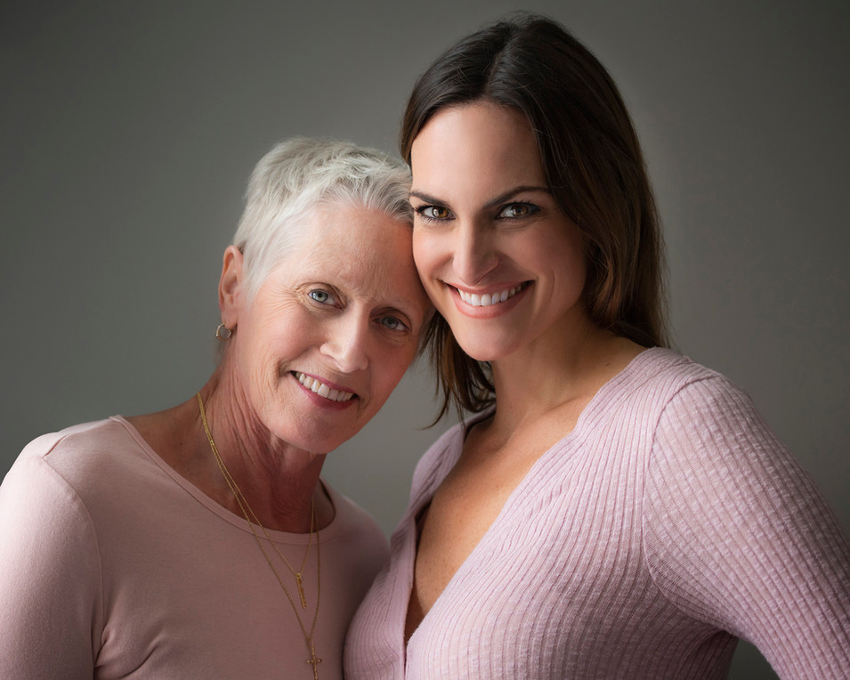 Professional studio family portrait of elderly woman and daughter