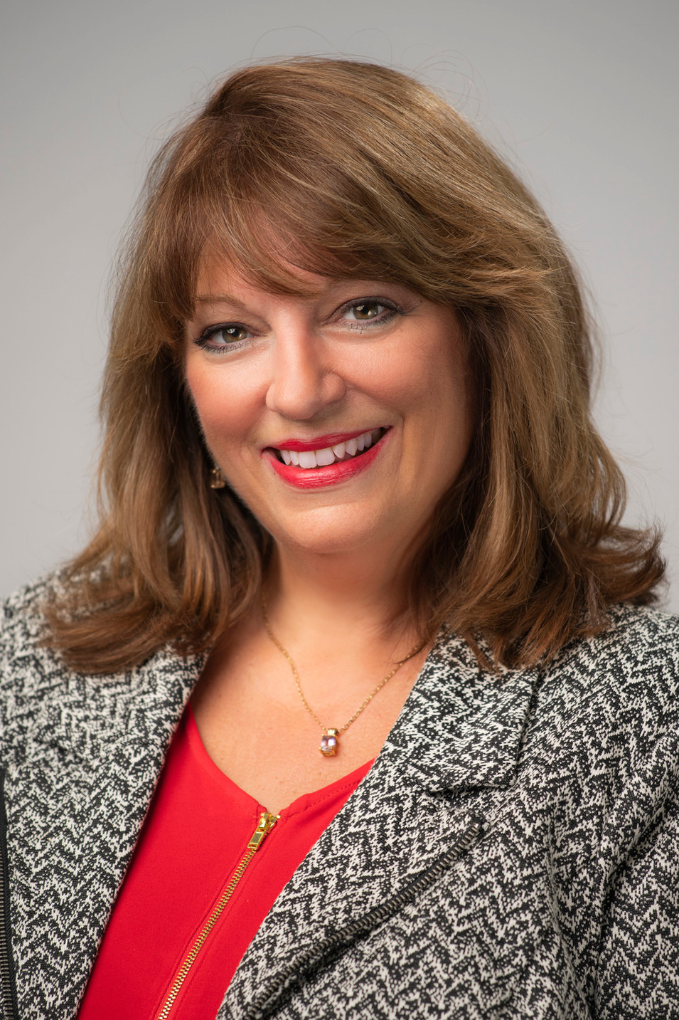 Studio Headshot of a middle age woman