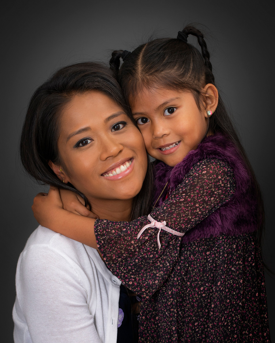 Professional studio family portrait of a young mother and daughter