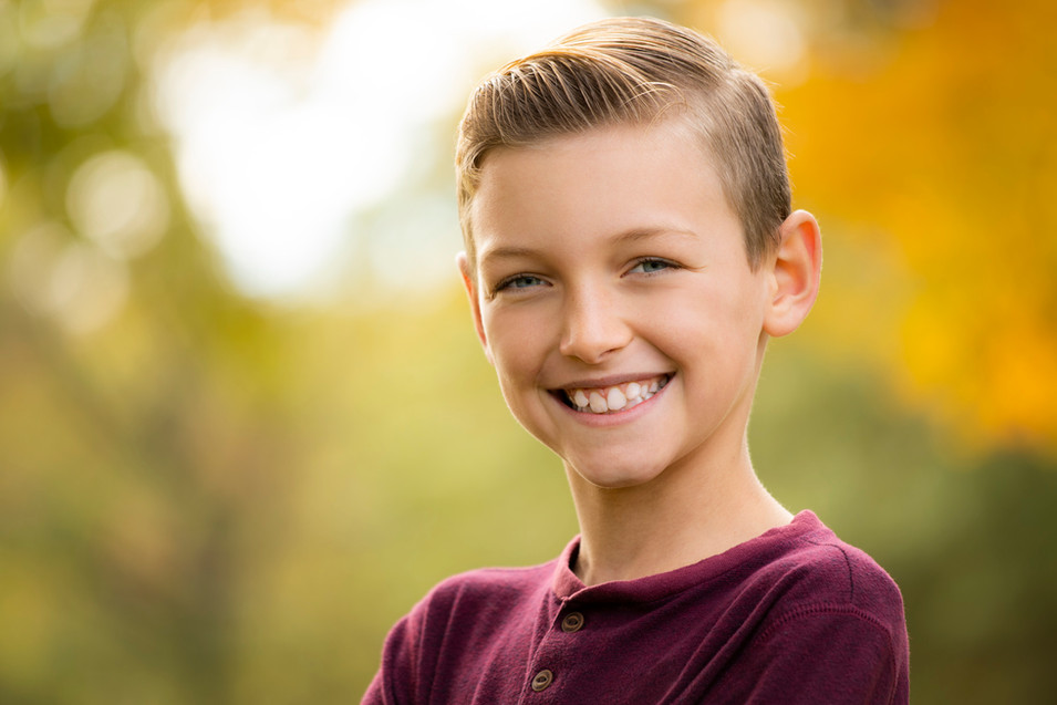 Professional outdoor portrait of a boy