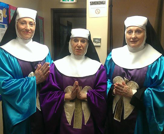The nuns behind the stage