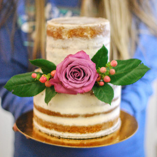 A beautiful naked cake by a student from Shelby Bower's Naked Cake Workshop.