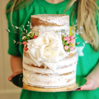 A garden rose, naked cake by a student from Shelby Bower's Naked Cake Workshop.