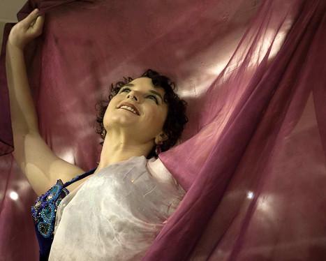 Pink veil belly dancer Tara Yasmin