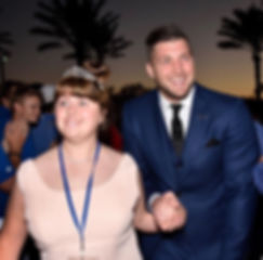 Night-to-Shine-2017-Tim-Tebow-walks-Quee