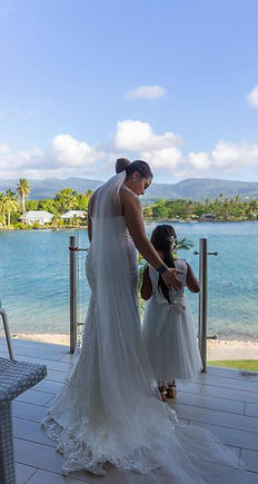 Ashley in her wedding gown  and Daughter Alani in her custom made flowergirls dress