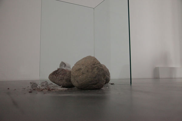 Cracked stone behind glass