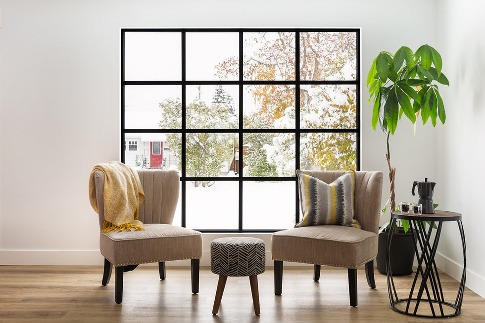 Two chairs in front of a custom 16 pane window