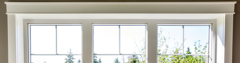 Three white windows in a white room